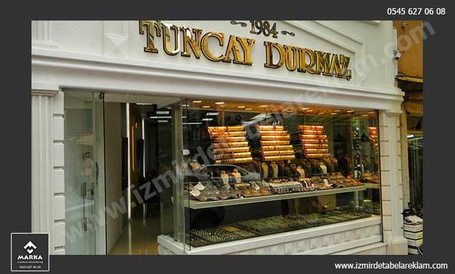 Krom Kutu, İzmir Tabela